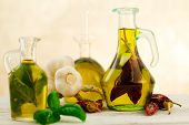 image of flavor  - oil bottles flavored with herbs and spices - JPG