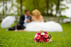pic of wedding  - Wedding couple and flower bouquet on a wedding day - JPG
