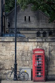 picture of phone-booth  - Red phone booth an iconic symbol of British heritage and an old bicycle on the streets of oxford England - JPG