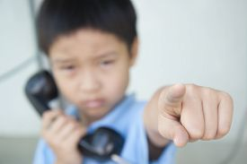 pic of phone-booth  - Focus hand of Boy using the old public phone booth  - JPG