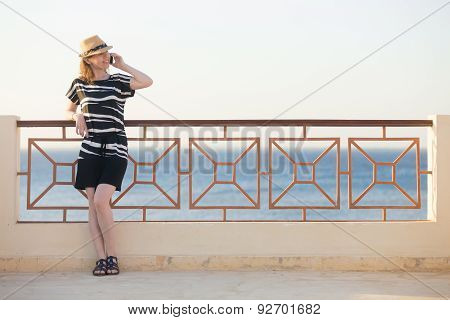Young Woman On Phone On Sea Resort