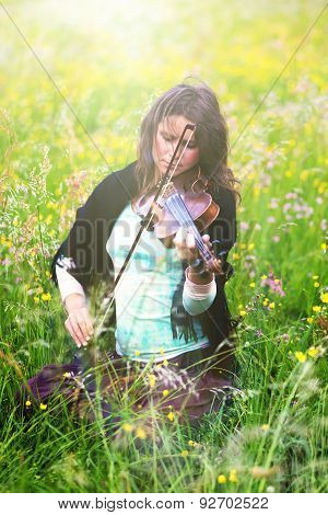 Violinist On A Meadow Full Of Flowers, Young Girl Playing Music Instrument.