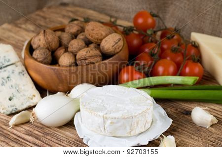 Whole Camembert Cheese On Board With Vegetable