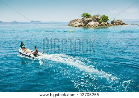 Dive Boat Heading To The Island In A Tropical Sea