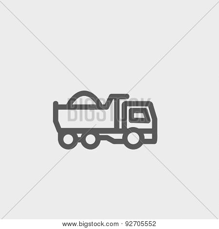 Dump truck icon thin line for web and mobile, modern minimalistic flat design. Vector dark grey icon on light grey background.