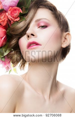 Beautiful lady with a wreath of flowers