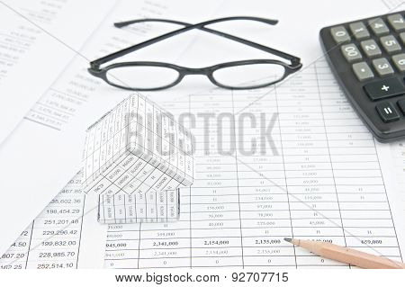Pencil And House On Finance Account With Spectacles And Calculator