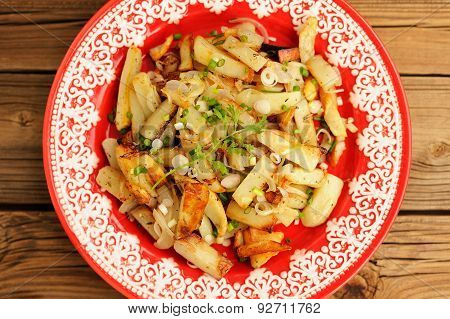 Fried Potatoes With Scallion In Red Plate Topview