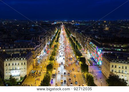 Streetview Of Famous Champs Elysees With Illumination And Traffic In Paris