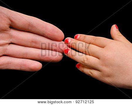Big Hand Palm Meeting Small Girl Hand With Cracked Pink Nail Paint Isolated On Black