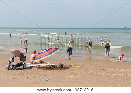 Seaside Visitors  Relaxing At Dutch Beach Of Scheveningen