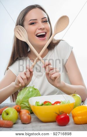 Beautiful young girl is making tasty healthy food