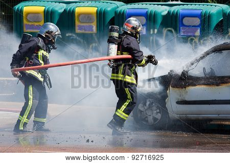 Two Firefighters In Action