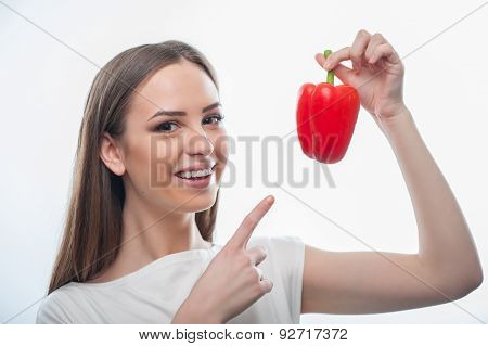 Pretty healthy girl with red tasty vegetable