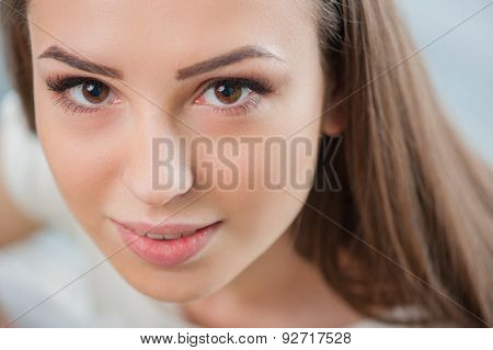 Cheerful young woman is showing her admiration