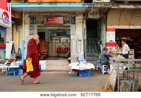 Burmese Monks Walking On Street In Yangon