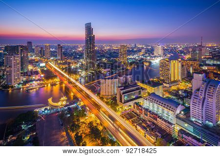 Landscape of Bangkok city at twilight time with bird view