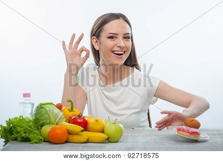 Pretty young girl is refusing to eat unhealthy food