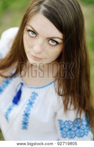 Girl With Freckles On Her Face In A Ukrainian Shirt
