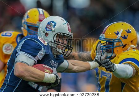 ST. POELTEN, AUSTRIA - JUNE 1, 2014: RB Veikka Lehtonen (#12 Finland) runs with the ball.