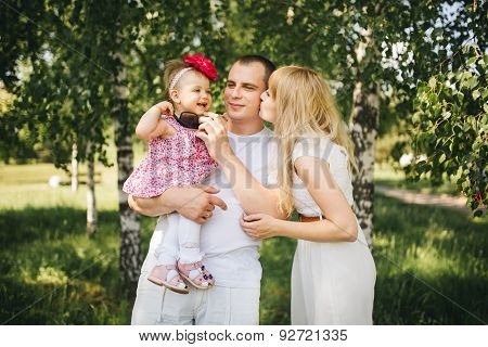 Happy Family On The Nature Dad Daughter Mom