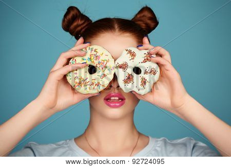 Young Girl With Dark Hair And Bright Makeup Holding Sweet Donuts