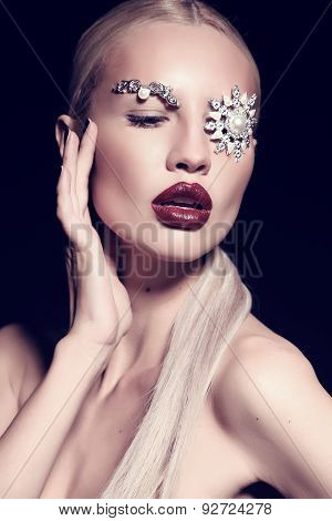 Sexy Blond Woman With Fantastic Makeup With Bijou Accessories