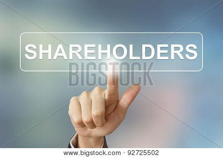 Business Hand Clicking Shareholders Button On Blurred Background