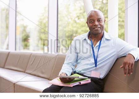Portrait Of Male College Tutor With Digital Tablet