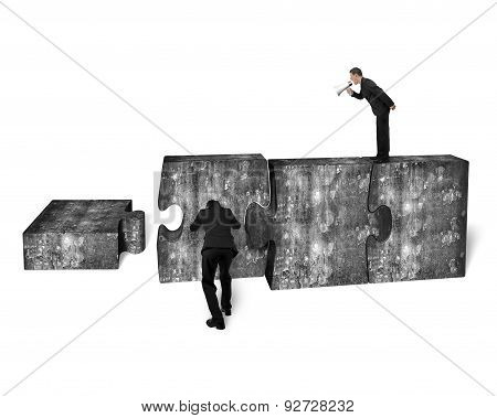 Businessman Speaker Yelling Other Pushing Jigsaw Puzzle Concrete Blocks