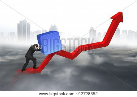 Business Man Pushing Blue 3D Block Upward Red Trend Line