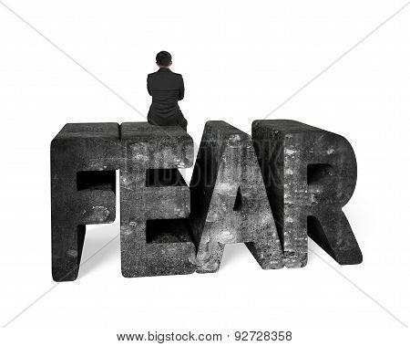 Man Sitting On Mottled 3D Fear Concrete Word