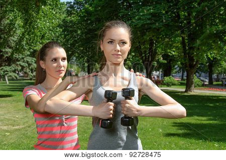 Fitness Woman Doing Exercises With Weights