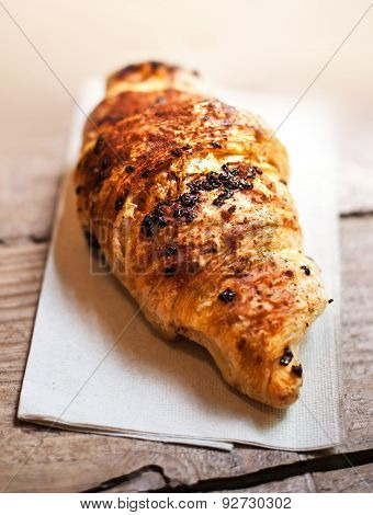 .chocolate Croissant Close Up.  Fresh And Tasty Croissant Over Wooden Background For Breakfast..