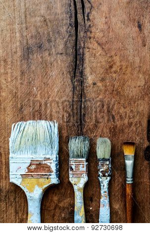 Grunge Paintbrush On Old Wood Background