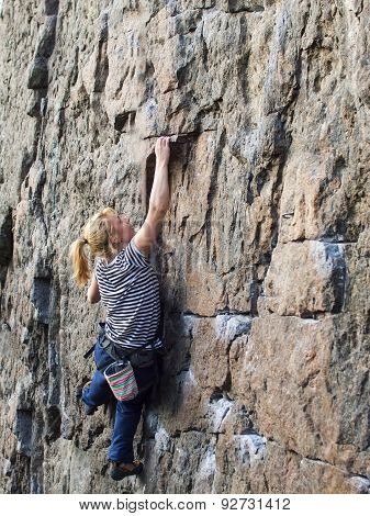 Young Woman With Rope Climbs On The Rock.