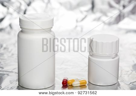 Medical capsules with white plastic bottle