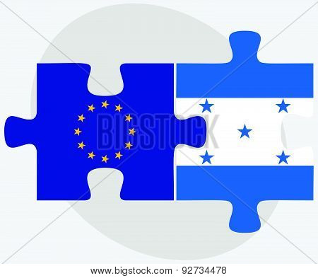European Union And Honduras Flags In Puzzle Isolated