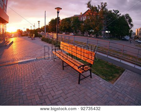 Urban Cityscape With Benches And Lanterns In The Evening