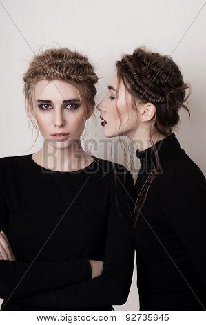 Young Girl Whispering Secret