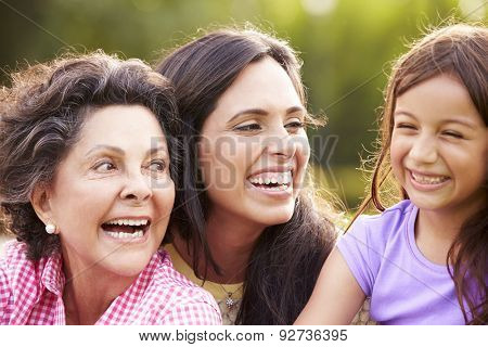 Grandmother With Granddaughter And Mother In Park