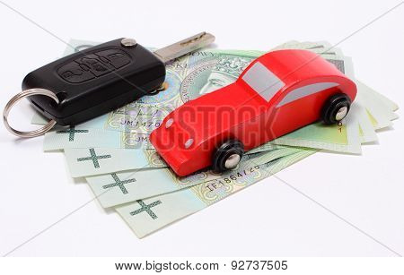 Money, Wooden Red Toy Car And Key Vehicle. White Background
