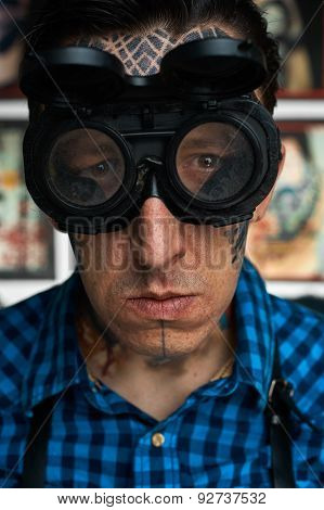 Portrait Of Tattoo Master In Welder Glasses