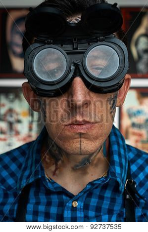 Portrait Of Tattooist In Welder Glasses