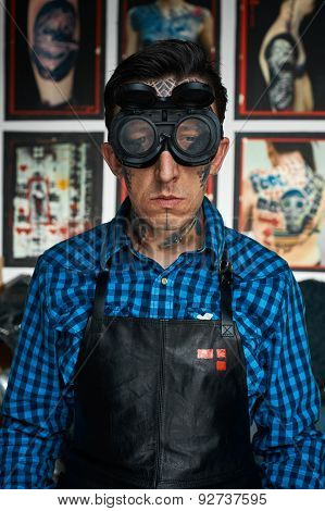 Tattoo Artist In Welder Glasses In Studio