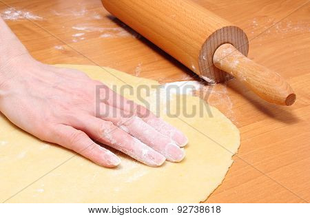 Hand Of Woman Preparing Dough For Yeast Cake