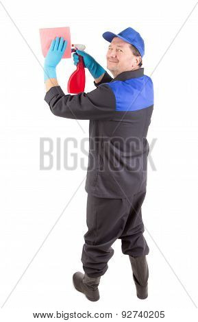 Worker holding spray bottle and sponge.