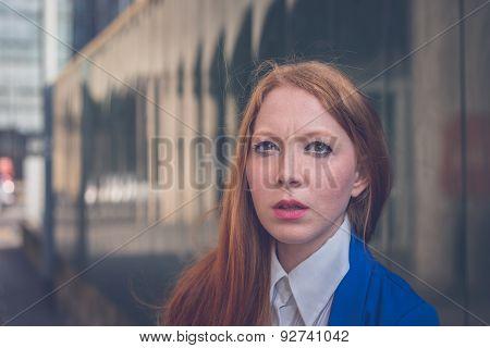 Beautiful Redhead Girl Posing In An Urban Context