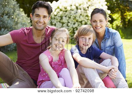 Portrait Of Family Relaxing In Summer Garden