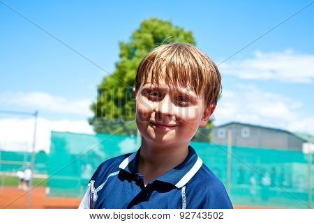 Child Looks Happy And Satisfied After The Tennis Match